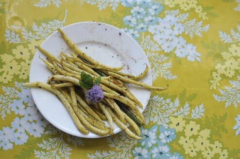 Plate of fresh green beans and flower - BLEF06025