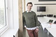 Successful, young businessman in boardroom - UUF17730