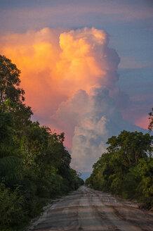 Beautiful illuminated cloud above a dirt track, Pantanal, Brazil - RUNF02369