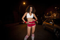 Woman wearing retro costume at night - BLEF06281
