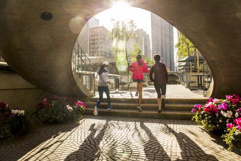 Women running in urban park - BLEF06539