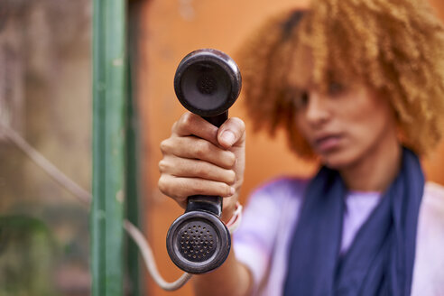 Woman holding old-fashioned telephone receiver - VEGF00294