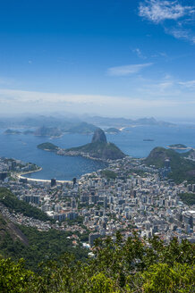 Outlook from the Christ the Redeemer statue over Rio de Janeiro with Sugarloaf Mountain, Brazil - RUNF02374