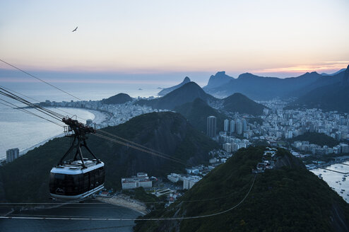 View from the Sugarloaf Mountain with cable car at sunset, Rio de Janeiro, Brazil - RUNF02389