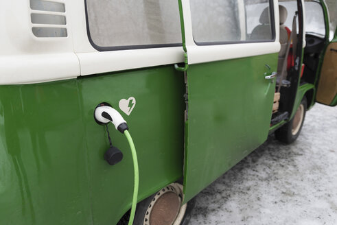 Electric van is being charged in winter landscape, Kuopio, Finland - PSIF00286
