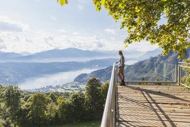 Woman standing on observation point above Millstatt Lake, Carinthia, Austria - GWF06077