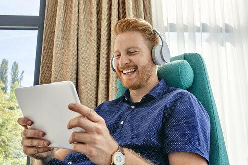 Serbia, Novi Sad, Man, Digital Tablet, Headphones - ZEDF02306