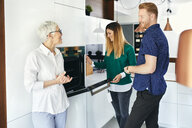 Couple shopping for a new kitchen in showroom - ZEDF02421