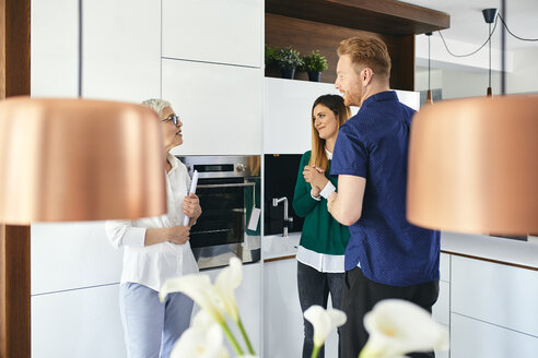 Couple shopping for a new kitchen in showroom - ZEDF02424