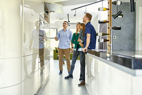 Family shopping for a new kitchen in showroom - ZEDF02454