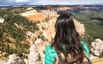 Women hiker with backpack on a lookout in Bryce Canyon, Utah, USA - GEMF02976
