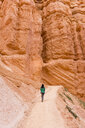 Woman carrying her daughter in a baby carrier walking on path, Bryce Canyon, Utah, USA - GEMF02982