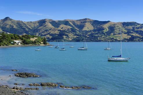 Little boats in the Akaroa harbour, Banks Peninsula, South Island, New Zealand - RUNF02569