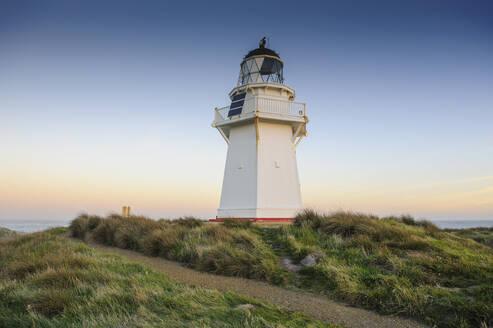Waipapa Point Lighthouse at sunset, the Catlins, South Island, New Zealand - RUNF02584