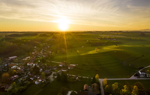 Aerial view with sunrise over Holzhausen, Bavaria, Germany - LHF00646