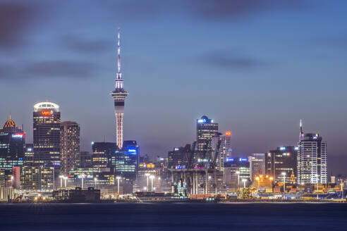 Auckland skyline lit up at night, New Zealand - MINF11595