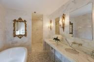 Bathtub and mirrors in ornate bathroom - MINF11715