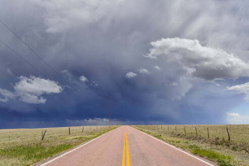 Storm clouds over open road, Rush, Colorado, United States - MINF11937
