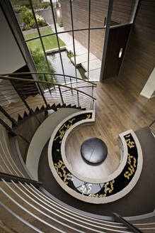 Overhead view of pond in modern foyer - MINF11970