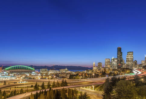 City skyline lit up at night, Seattle, Washington, United States - MINF11985