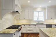 Counters and cabinets in luxury kitchen - MINF12093