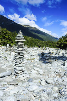 Man made stone pyramids at the Blue Pools, Haast Pass, South Island, New Zealand - RUNF02619