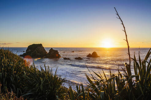 Sunset at Cape Foulwind near Westport, South Island, New Zealand - RUNF02646
