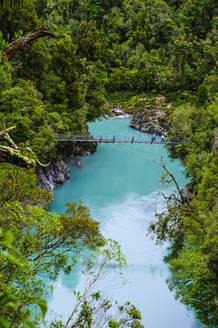 Hanging bridge above the turquoise water in the Hokitika Gorge, South Island, New Zealand - RUNF02649