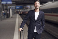 Mature man with trolley on station - PNEF01585