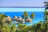 Palm trees overlooking tropical resort, Bora Bora, French Polynesia - MINF12236