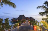 Deck and restaurant over tropical ocean, Bora Bora, French Polynesia - MINF12239