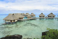 Bungalows over tropical ocean, Bora Bora, French Polynesia - MINF12242