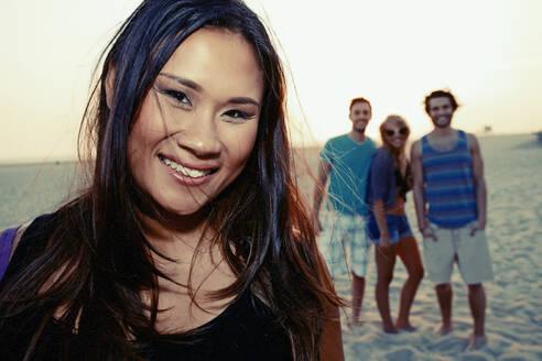 Woman smiling on beach - BLEF06801