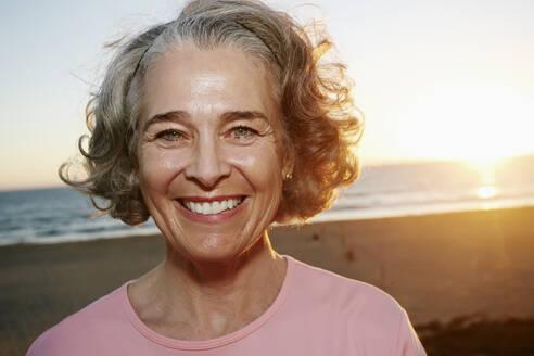Caucasian woman smiling at beach - BLEF06978
