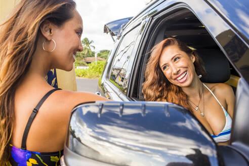 Smiling women talking in car - BLEF06993