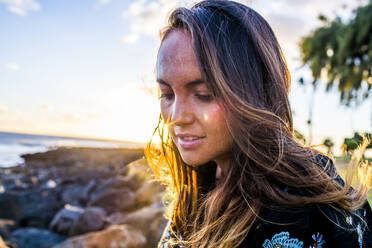 Close up of Caucasian woman on rocky beach - BLEF07002