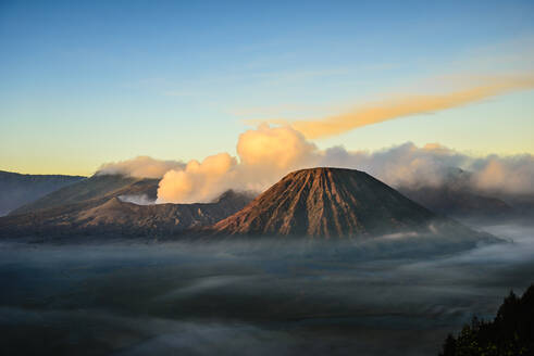 High angle view of clouds under smoking volcano - MINF12337