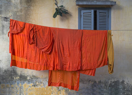 Buddhist monk robes hanging on clothesline - MINF12370