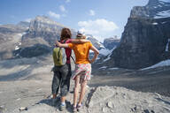 Caucasian mother and daughter admiring scenic view of Six Glaciers Trail, Banff, Alberta, Canada - MINF12376