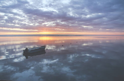 Boat on the Baltic Sea at a sunrise, Curonian Spit, Lithuania - IHF00128