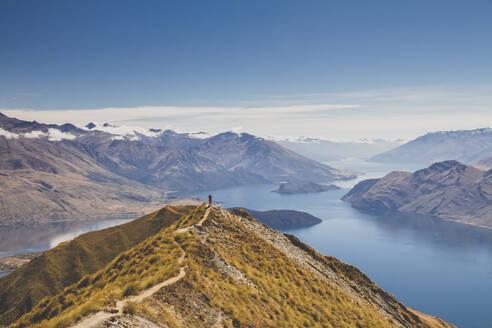 Woman standing on mountain top, Roys Peak, Lake Wanaka, New Zealand - IHF00131