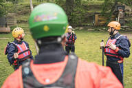 Instructor with group of friends at a rafting class - FBAF00722