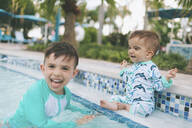 Happy little brothers in a swimming pool - CMSF00070