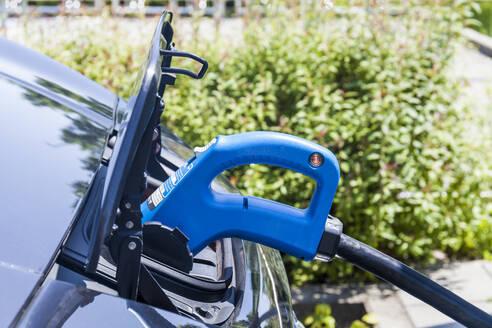 Charging of an electric car, close-up - TCF06098