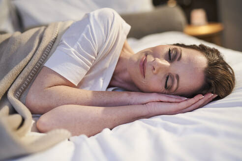 Content woman sleeping in bed - PNEF01659