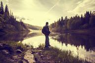 Caucasian man fishing at lakeside - BLEF07369