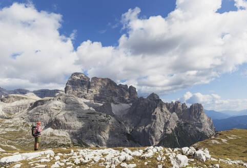 Hiker on hiking trail, Tre Cime di Lavaredo Aera, Nature Park Tre Cime, Unesco World Heritage Natural Site, Sexten Dolomites, Italy - GWF06124