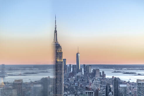 Skyline at sunset with Empire State Building in foreground and One World Trade Center in background, Manhattan, New York City, USA - MMAF01019