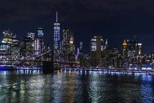 Skyline at night with East River and Brooklyn Bridge, Manhattan, New York City, USA - MMAF01049
