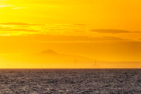 Wind turbine and oil rig at sunset,  Fife Coast, Firth of Forth, Scotland - SMAF01256